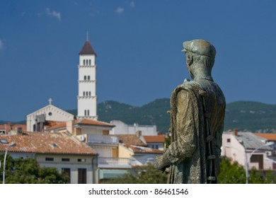 Statue of the Crikvenica`s fisherman pointing at the town
