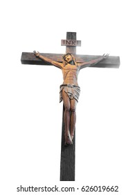 Statue of the crucifixion of Christ isolated on white background