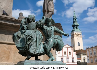 Statue of dancers, Novy Jicin, Czech Republic / Czechia - May 8, 2019: Small bronze monument  and town hall in the background. Very low depth of field