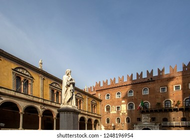 Statue of Dante Alighieri in Piazza dei Signori, Verona, Italy. Beautiful statues of Dante in the middle of Verona old town with other sculptures and architecture. Summer day in Verona