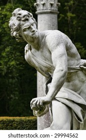 Statue of David killing Goliath with a slingshot, English garden
