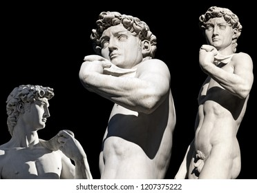 Statue of the David of Michelangelo Buonarroti isolated on a black background, marble sculpture in Piazza della Signoria - Florence, Italy, Europe