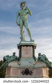 """Statue of David in Michelangelo square in Florence, Italy. Year 1873. Text: """"To Michelangelo Buonarroti, 4 centuries after his birth, dedicated by the municipality of Florence""""."""