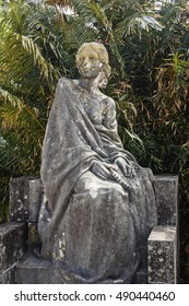 Statue in decay of a woman