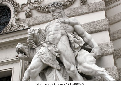 A statue depicting the ancient Greek hero Hercules and his exploits. Sculpture on the facade of a historic old building in Vienna. Fighting the dog Cerberus.