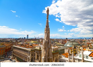 A statue of the Dome of Milan cathedral with the city view in summer. Aerial view of Milan downtown from height of dome steeple.