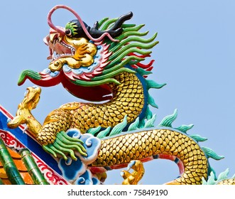Statue of dragon on the roof of Chinese temple