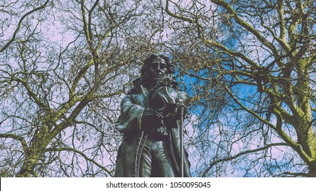 Statue of Edward Colston in Bristol City Centre split toning H, mid view shallow depth of field horizontal photography