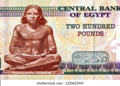 the statue of the Egyptian scribe Portrait from Egypt 200 Pounds Banknotes. An Old paper banknote, vintage retro. Famous ancient Banknotes. Collection.