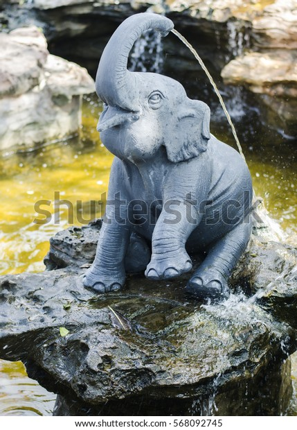 The Statue of Elephant in pool.