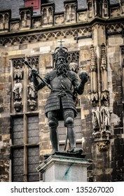 Statue of emperor Charlemagne (Charles the great) in front of the gothic town hall in his home city Aachen in Germany.