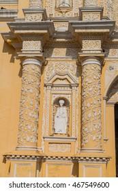 Statue at the facad of La Merced Church in Antigua, Guatemala