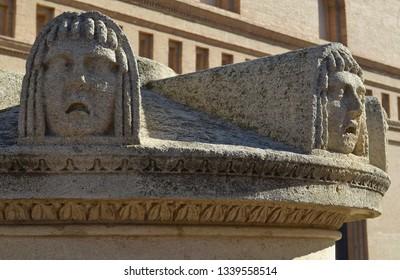 A statue with faces in Plaza del Pillar, Zaragoza, Spain