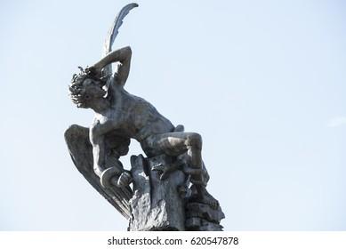 "Statue of fallen Angel in the ""retiro"" Park"