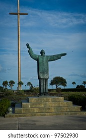 Statue of Father lopez and large cross at the site of Mision Nombre de Dios in Saint Augustine Florida