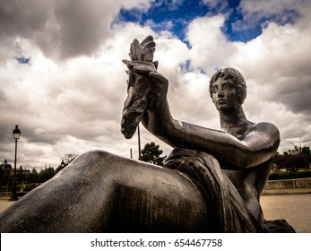 Statue of a female at Jardin de Tuileries in Paris, France with the sky background.