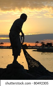 Statue of fisherman during sunset