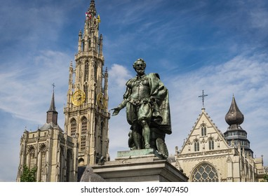 Statue of the Flemish painter Rubens in a square in the Belgian city of Antwerp with the cathedral in the background.