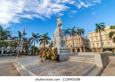 Statue of José Martí with flower arrangement, was a Cuban National Hero and important figure in Latin American literature, at Parque Central, Havana, Cuba.