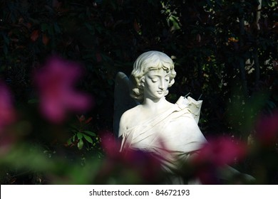 Statue with flowers in Bonaventure Cemetery