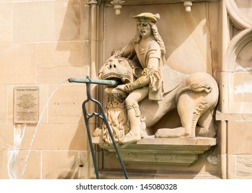 Statue from fountain at Schwabisch Hall, Germany with statues of Samson, St Michael and St George. The rectangular design, unusual in a Gothic fountain, includes the old pillory post.