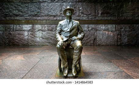 Statue of Franklin Roosevelt sitting in his wheelchair  in The Franklin Roosevelt Memorial in Washington DC, USA on 13 May 2019