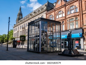 Statue of Fred Dibnah with town hall in background in Bolton Lancashire July 2020