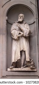 A statue Galileo Galilei sitting outside of the Uffizi, in Florence, Italy.  Galileo is a famous astronomer.