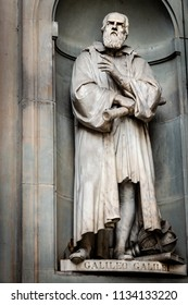 A statue of Galileo Galilei sitting outside of the Uffizi, in Florence, Italy.