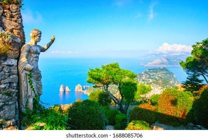 Statue at garden on Capri Island town, Italy. Amalfi scenery and Solaro mountain. Landscape with sculpture and Blue Mediterranean Sea, Italian coast. Anacapri in Europe. View on Faraglioni, summer.