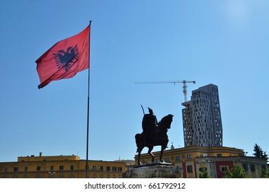 Statue of George Castriot (Skanderbeg) and the national flag of Albania, Tirana, Albania