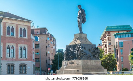 Statue of Giuseppe Verdi, in the front of Casa Verdi timelapse Milan, Italy. Traffic on the road. Blue sky at summer day