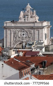 Statue of Glory rewarding Valor and Genius on the Rua Augusta Arch in Lisbon, Portugal, a symbol of the city's recovery from the 1755 earthquake, sculpted by Celestin Anatole Calmels in 1875.