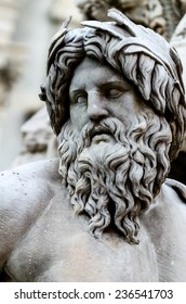 Statue of the god Zeus in Bernini's Fountain of the Four Rivers in the Piazza Navona, Rome - detail of the allegorical Ganges figure