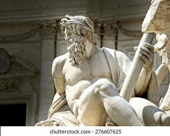 Statue of the god Zeus in Bernini's Fountain of the Four Rivers in the Piazza Navona, Rome