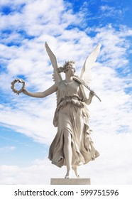 Statue of the goddes Nike, blue sky and clouds, angel from Schwerin Castle garden, Germany