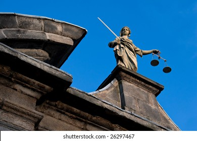 a statue of the goddess of justice atop a building