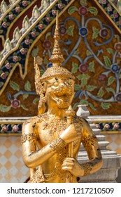 Statue in gold at the Grand Palace in Bangkok, Kingdom of Thailand. South East Asia.