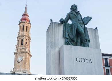 statue of goya in front of la seo, cathedral of zaragoza, spain