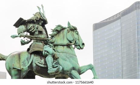 Statue of the great samurai Kusunoki Masashige, famed Japanese samurai at the East Garden outside Tokyo Imperial Palace in Tokyo, Japan.