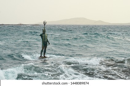 Statue of Greek God Neptune at Melenara Beach on Gran Canaria Island