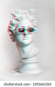 Statue. Gypsum statue of Apollo's head. Man. Creative. Plaster statue of Apollo's white sunglasses. Head. Sculpture.