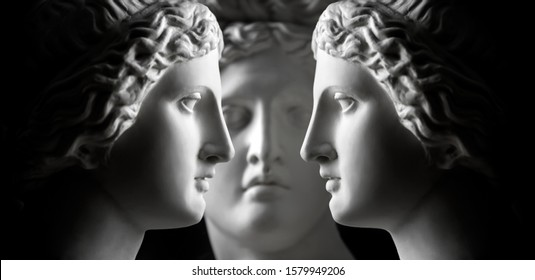 Statue. Gypsum statue of Venus head. Gypsum statue of Apollo's head and of Venus. Black Lives Matter. racism. Racial discrimination. Афродита. Аполлон. Commitment. Connection. Love triangle. mutation