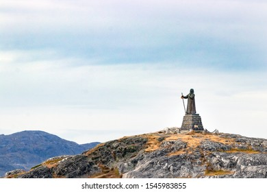 The Statue of Hans Egede on the top of a hill overlooking Nuuk, together with the Sermitsiaq Mountain.
