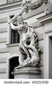 Statue of Heracles defeating the lernaean hydra in Vienna, detail of Hofburg imperial palace facade from Michaelerplatz square