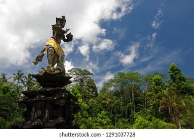 Statue of Hindu God Indra Bringing Holy Water at Tirta Empul temple, Pura Tirta Empul, Hindu Balinese water temple, Tampaksiring, Bali, Indonesia