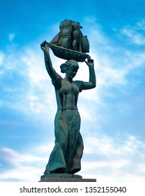 Statue holding a ship over her head, in Drammen, Norway.