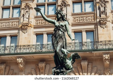 The statue of Hygieia - the goddess of health and hygiene - that decorates the fountain in the courtyard of Rathaus. Rathaus is the famous Hamburg City Hall, Germany.