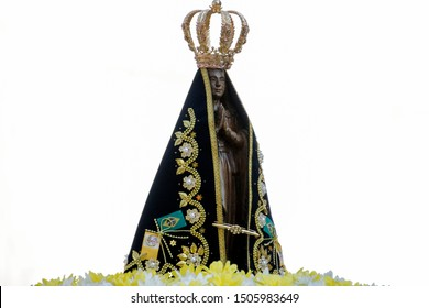 Statue of the image of Our Lady of Aparecida, mother of God in the Catholic religion, patroness of Brazil, decorated with flowers in open parade