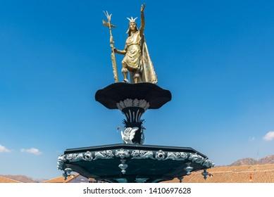 Statue of Inca Pachacutec on top of the fountain of Plaza de Armas, Cuzco, Peru